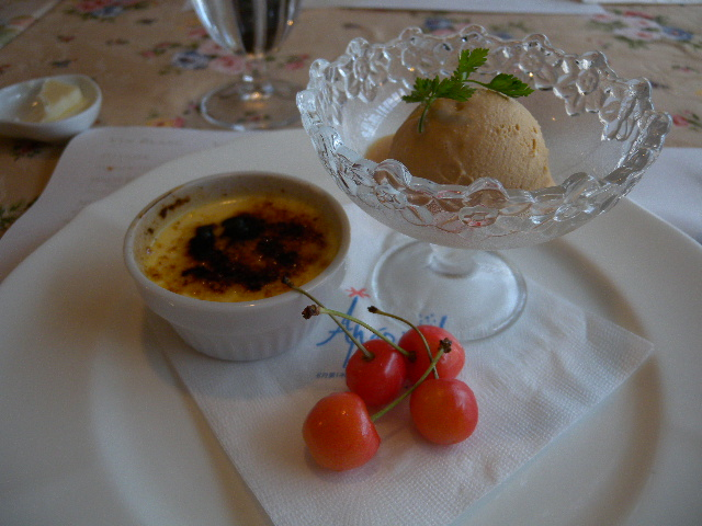 Crème brulée, caramel ice cream, small cherries